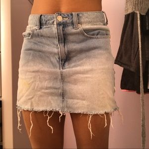 Distressed denim skirt with white lining